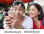 asian younger man and woman... | Shutterstock . vector #354345614