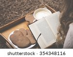moment with a book and coffee | Shutterstock . vector #354348116