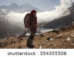 an asian lady is trekking in... | Shutterstock . vector #354355508