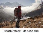 an asian lady is trekking in... | Shutterstock . vector #354355508
