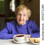 Elderly Woman Drinking Tea In...