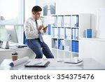businessman sitting on the edge ...   Shutterstock . vector #354375476