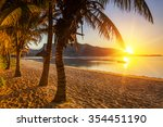 Stock photo paradise sandy beach with palm trees and mountains at sunset mauritius 354451190