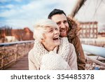 young couple having fun on city ... | Shutterstock . vector #354485378