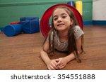 girl playing in the kindergarten | Shutterstock . vector #354551888