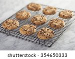 cookies on a cooling rack over... | Shutterstock . vector #354650333