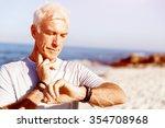runner checking his heart rate... | Shutterstock . vector #354708968