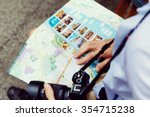 happy male tourist in city with ... | Shutterstock . vector #354715238