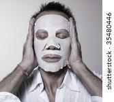 studio portrait of a man using... | Shutterstock . vector #35480446