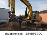 worker at a construction site... | Shutterstock . vector #354898700