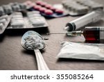 drug syringe and cooked heroin... | Shutterstock . vector #355085264