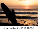 silhouette of a surfer during... | Shutterstock . vector #355240658