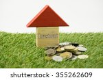 house wooden block with coins... | Shutterstock . vector #355262609