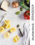 raw and fresh big tortellini in ... | Shutterstock . vector #355420319