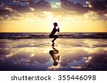 silhouette of woman practicing... | Shutterstock . vector #355446098