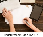 woman's hand writing on white... | Shutterstock . vector #355465814