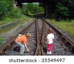 couple children on the railway | Shutterstock . vector #35549497
