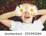 Child With Daisy Eyes  On Gree...
