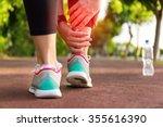 female athlete runner touching...   Shutterstock . vector #355616390