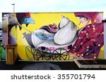 Small photo of VITRY-SUR-SEINE, FRANCE -24 DEC 2015- Street art wall mural entitled Femme au Landau (woman with stroller) by French graffiti artist Inti Ansa in Vitry.