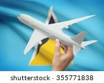 airplane in hand with national... | Shutterstock . vector #355771838