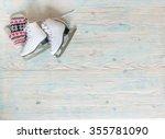 ice skates with mitten on... | Shutterstock . vector #355781090