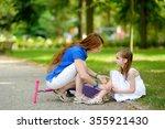 mother comforting her daughter... | Shutterstock . vector #355921430