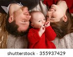 Joyful Young Family With A Bab...