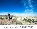 lonely traveler looking into... | Shutterstock . vector #356062538
