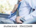 hand fastening a seat belt ... | Shutterstock . vector #356122688