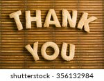 Small photo of Sweet acknowledged with Thank You word composed of homemade biscuits letters