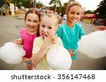 Happy Girls Eating Cotton Cand...