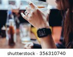 young woman drinking with smart ... | Shutterstock . vector #356310740
