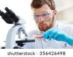 chemist studying new substance... | Shutterstock . vector #356426498