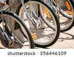 row of parked vintage bicycles... | Shutterstock . vector #356446109