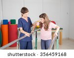 physical therapist with... | Shutterstock . vector #356459168
