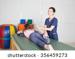 physical therapist  giving  a   ... | Shutterstock . vector #356459273