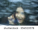 Little Girl Looking Out Of Car...