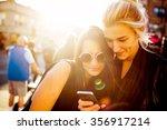 girlfriends with a smart phone   Shutterstock . vector #356917214