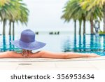 woman wearing hat in the hotel... | Shutterstock . vector #356953634