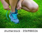 put on running shoes on the... | Shutterstock . vector #356988326