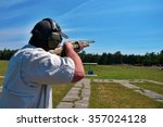 Man Shooting Skeet With Shotgun