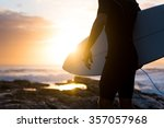surfer standing on the rocks at ... | Shutterstock . vector #357057968