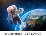 astronaut over earth   elements ... | Shutterstock . vector #357114404