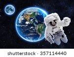 astronaut over earth   elements ... | Shutterstock . vector #357114440