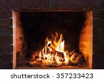 Burning fireplace. Fireplace as a piece of furniture - stock photo