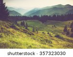 misty summer mountain hills... | Shutterstock . vector #357323030