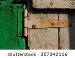 Small photo of Wall. Walls. Walls and paints. Green door. Rowlock. Door hinge. Simple Life. Indian style. Backgrounds. Textures. Smell.
