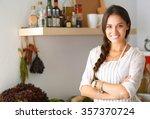 young woman standing near desk... | Shutterstock . vector #357370724