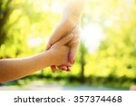 hands of mother and daughter... | Shutterstock . vector #357374468